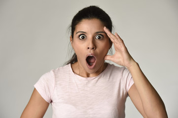 young beautiful surprised woman amazed in shock and surprise with mouth big opened