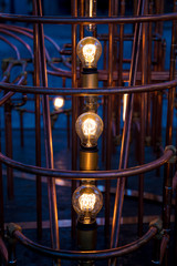 Incandescent light bulbs between pipes