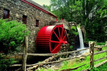 Sudbury, Massachusetts- July 10, 2013:   Wayside Inn's Grist Mill with water wheel and mill stream cascade  *
