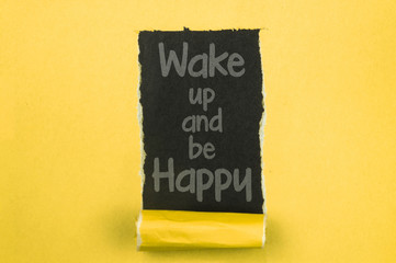 Wake Up And Be Happy. Words written under torn paper. Motivation concept text.