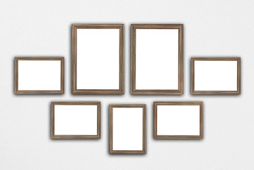 picture frame set on brick wall
