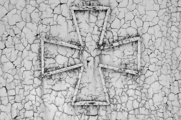 Cross on a rust metall background