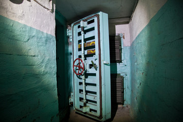 Hermetic door of an abandoned Soviet bomb shelter, an echo of the Cold War