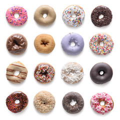 Set of assorted donuts isolated on white background. Include cli