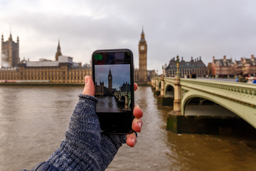Taking and posting photo of Big ben in winter morning