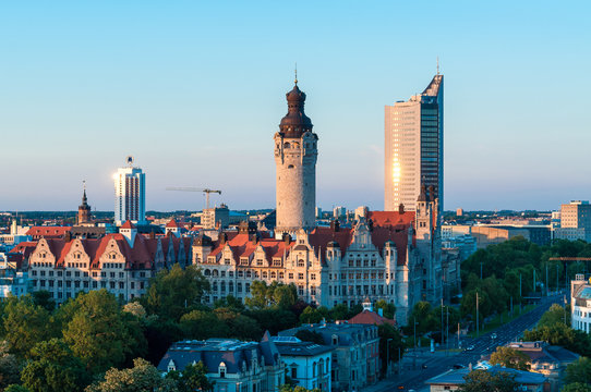 skyline of Leipzig with townhall and high court at sunset, Germany