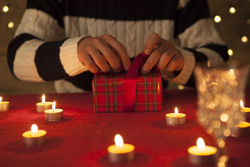 Men are opening gifts