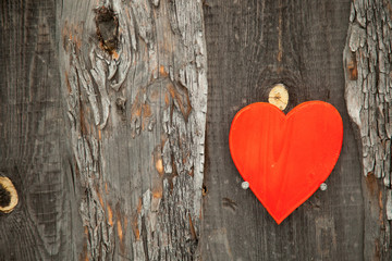 Red heart on a rustic wooden background. St. Valentine's Day