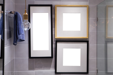 Wood picture frame on  plank wall in Bathroom