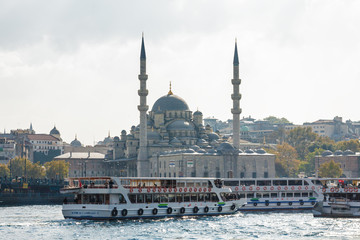 Sunny view of Bosphorus with excursion boats and Blue mosque, Istanbul, Turkey.