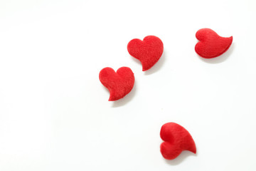 The four red hearts for Valentine's Day decorations. On a white background
