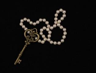 vintage metal key on black background