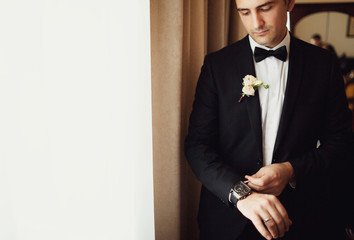Young groom in the hotel room before the wedding