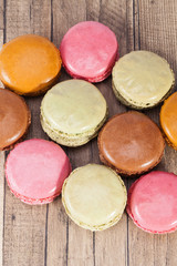 Colorful cookies of macaroon isolated on wooden plank