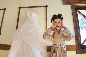 shocked bride in bathrobe screaming because she is late