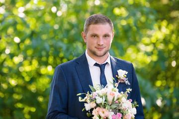 a groom outdoors