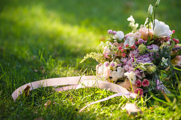wedding fresh bouquet lays on the grass