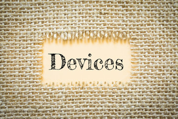 Text Devices on paper Orange has Cotton yarn background you can apply to your product.