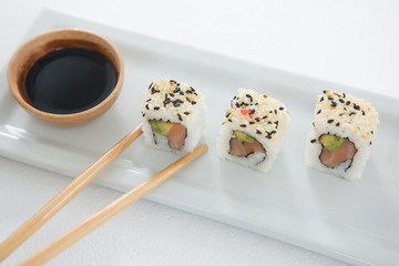 Sushi on tray with sauce