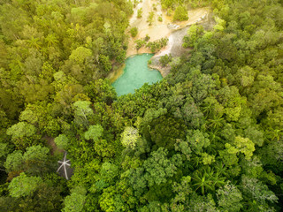 Aerial view of Natural emerald pond with amazing blue color water in Krabi province of Thailand