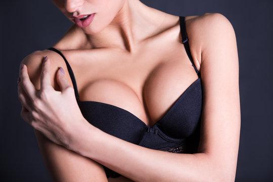 close up of female breast in black lace bra