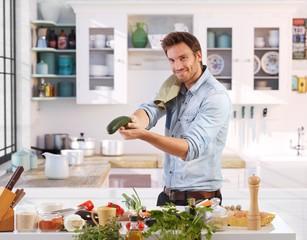 Playful man having fun in kitchen
