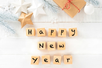HAPPY NEW YEAR text on white wood background