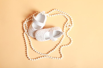 white baby shoes with pearls