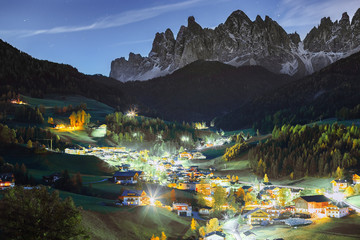 Wall Mural - Santa Magdalena Italian village at Funes rocks background. Beautiful travel background. Dolomite alps, night scene.