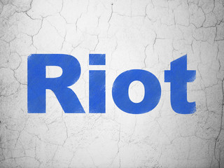 Political concept: Riot on wall background