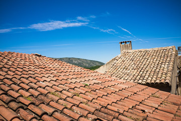 Mediterranean roofs with red tiles and blue sky in France