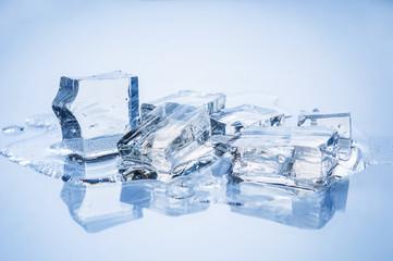 Melting ice closeup on blue background