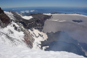The crater of Volcan Villarrica with light sulfur/steam rising