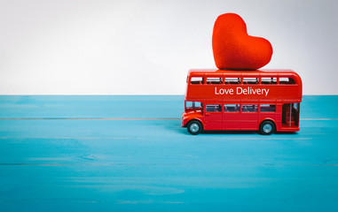 Love express on sightseeing bus with carrying red heart on roof