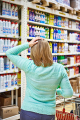 Woman in store with shopping cart