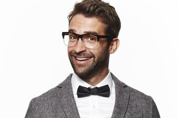 Smiling geek guy in bow tie, portrait
