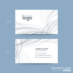 clean business card design with grey waves background