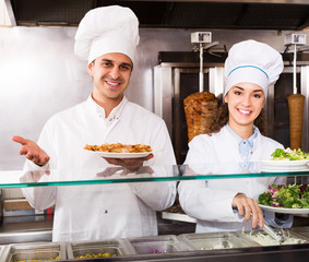 Staff posing at kebab counter