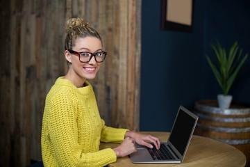 Beautiful woman using laptop in café