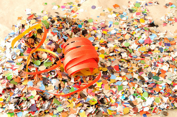 Carnival background, streamers and colorful confetti