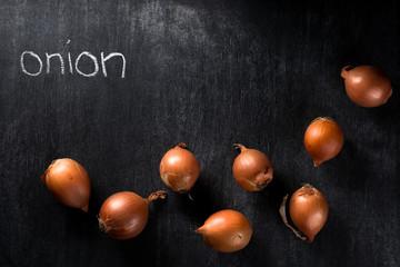 Onion over dark chalkboard background