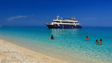 holidays, blue color, ship sea and clouds in Lefkada island, Porto Katsiki , Greece