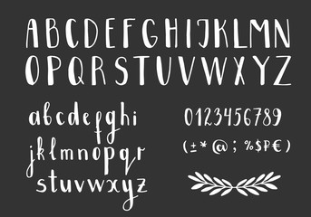 Set of handwritten latin letters. Vector script font. White alphabet isolated on black background.