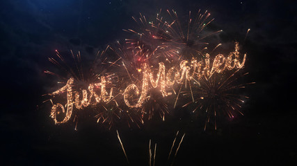Just Married wedding celebration greeting text with particles and sparks on black night sky with colored fireworks on background, beautiful typography magic design.
