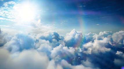 Flying over the timelapse clouds with the afternoon sun. Flight through moving cloudscape with beautiful lens flare. Traveling by air. Perfect for cinema, background