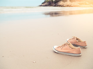 Canvas shoes on the sand beach