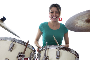 brunette brazilian woman plays the drums in studio
