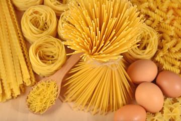 Uncooked Italian pasta and eggs