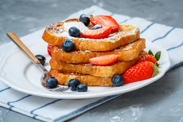 French toast with berries. Love for a healthy desserts concept.