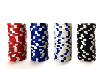 Casino chips in column isolated on white background